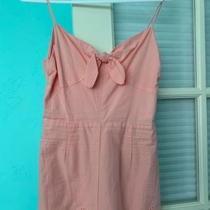 Light pink romper.